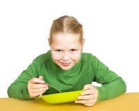 Girl eats isolated Stock Photography