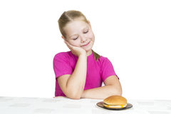 Girl eats isolated on the white Stock Image