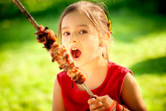 Girl eats kebab Royalty Free Stock Images