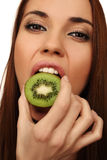 The girl eats a kiwi Stock Images