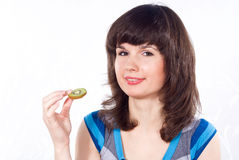 Girl eats kiwi Stock Photos
