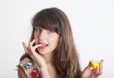 The girl eats a lemon Royalty Free Stock Photo