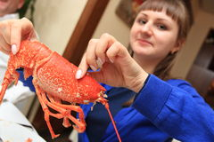 Girl Eats Lobster Royalty Free Stock Photography