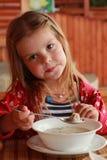 Girl eats meat dumplings. Cute girl is eating meat dumplings in a farm restaurant Stock Photography