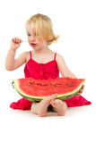 Girl eats melon teaspoon Royalty Free Stock Images