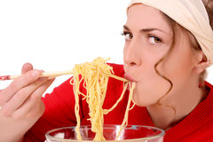 Girl eats pasta. Portrait of a girl who eats pasta royalty free stock photo