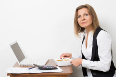 Girl eats a pasta, working behind the laptop Stock Photo