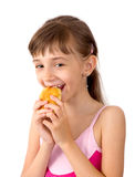 The girl eats a patty Royalty Free Stock Image