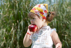 Girl eats peach Royalty Free Stock Photo