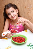Girl eats raspberries Stock Photo
