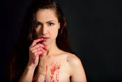 Girl eats raspberry jam finger Royalty Free Stock Photos