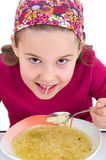 Girl eats soup Royalty Free Stock Photos