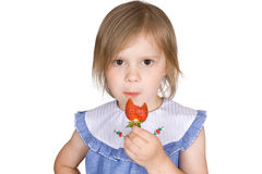 The girl eats a strawberry Stock Photography