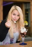 Girl eats sundae chocolate ice cream Royalty Free Stock Images