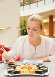 Girl Eats Sushi Royalty Free Stock Photos