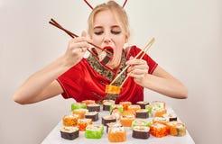 Girl eats sushi Royalty Free Stock Image