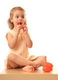 Girl eats a sweet pepper. Royalty Free Stock Photo