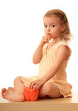 Girl eats a sweet pepper. Stock Images