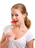 Girl eats tomato Royalty Free Stock Photos