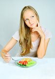 Girl eats vegetables Royalty Free Stock Image