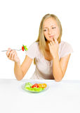 Girl eats vegetables Stock Images
