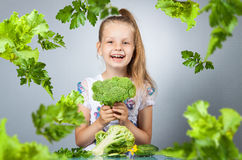 Girl eats vegetables Royalty Free Stock Photography