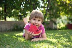 Girl eats a water-melon Royalty Free Stock Photos