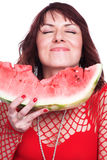 The girl eats a water-melon Stock Photography