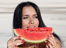Girl eats a water-melon Stock Photo