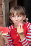 Girl eats watermelon Royalty Free Stock Images