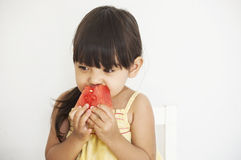 Girl eats watermelon royalty free stock photography