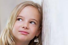 Girl eavesdropping stock photography