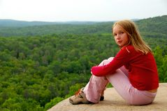 Girl edge cliff Stock Photography