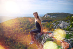 The girl on the edge of the cliff Stock Photography