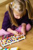 Girl with educational pin puzzle toy Royalty Free Stock Photography