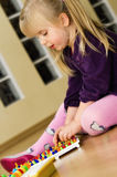 Girl with educational pin puzzle toy Stock Photos