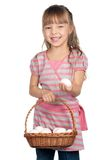 Girl with eggs Stock Image