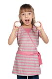 Girl with eggs Stock Images