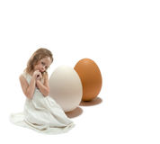 Girl with eggs Stock Photos