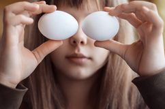 Girl with eggs. Royalty Free Stock Image