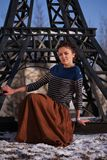 Girl beside Eiffel Tower model Royalty Free Stock Photo
