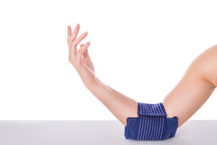 Girl with an elbow injury, ice-cooled gel. Royalty Free Stock Photography