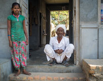 Girl and elderly man Stock Image