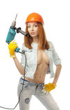Girl with an electric drill Stock Photo