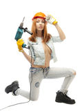 Girl with an electric drill Royalty Free Stock Photography