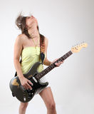 Girl with electric guitar Stock Photos