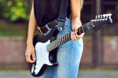 Girl with electric guitar - close up Royalty Free Stock Image