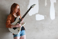 Girl with electric guitar rock Royalty Free Stock Images