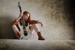 Girl with electric guitar rock Stock Images