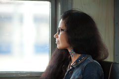 The girl and an electric train window Royalty Free Stock Photography